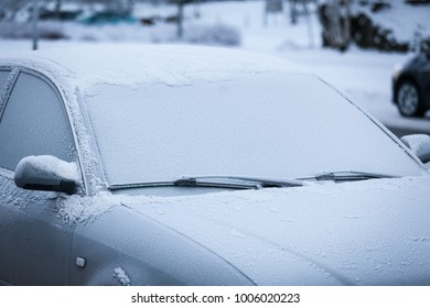 Car windshield covered in frost