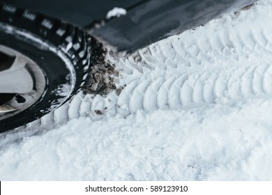 car, winter, people and vehicle concept - closeup of man pushing car stuck in snow