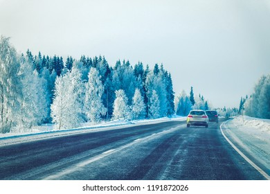 Car in the winter road in Rovaniemi at Lapland in Finland