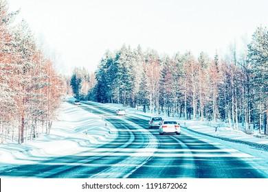 Car in the winter road in Rovaniemi of Lapland, Finalnd