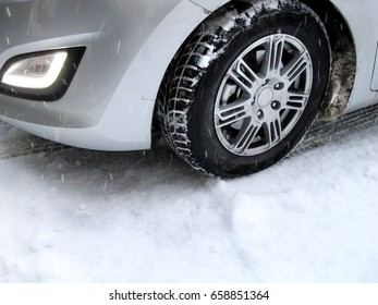 car with winter tires and a lot of snow