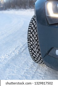 Car winter tyre on the snow. Slippery wintry road with unstudded tires. Modern car with good winter tires is safe to drive.