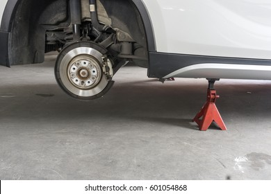 Car without wheel and lift up by jack stand ( axle stand ), waiting for tire replacement