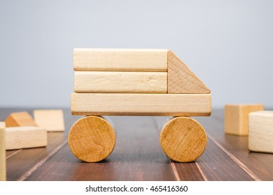 Car from wooden toy blocks on wooden board background, concept image