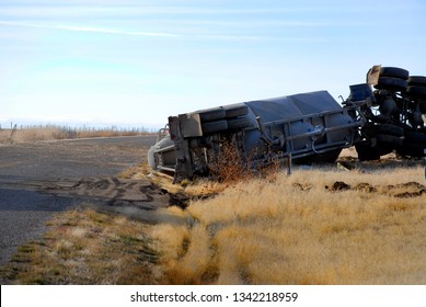 Car wreck of semi truck trailer rolled over crash crashed wrecked rollover