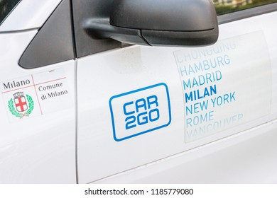 Car2Go White Car Rental Service for Sharing, Parked in the Street of Milan,Italy-September 2018