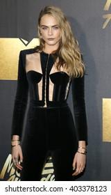 Cara Delevingne at the 2016 MTV Movie Awards held at the Warner Bros. Studios in Burbank, USA on April 9, 2016.