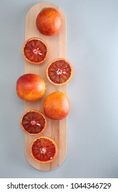 Cara cara navel oranges on a cutting board