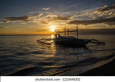 Carabao Island (Philippines) ,8 March 2018,Sunset and the boat