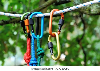 Carabiner with rope on nature background. Climbing uquipment.Climbing sports image of a carabiner on a rope.