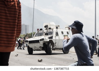 Caracas, Capital District /Venezuela; 04/30/2019: Military of the army of Maduro attack with vehicles to protesters