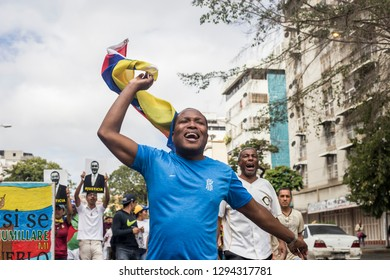 Caracas, Miranda/Venezuela - January 23rd 2019: Man sings while rallying in support of Venezuelan National Assembly President Juan Guaido.