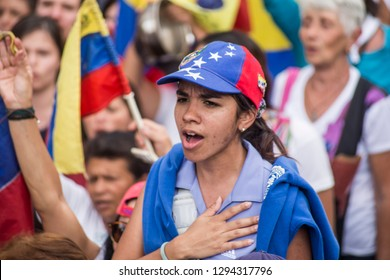 Caracas, Miranda/Venezuela - January 23rd 2019: Girl sings the national anthem at rally in support of Venezuelan National Assembly President Juan Guaido.
