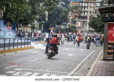 Caracas, Miranda/Venezuela - January 23rd 2019: Paramedics signal through protesters while clash with police after rally in support of Venezuela's National Assembly President Juan Guaido.