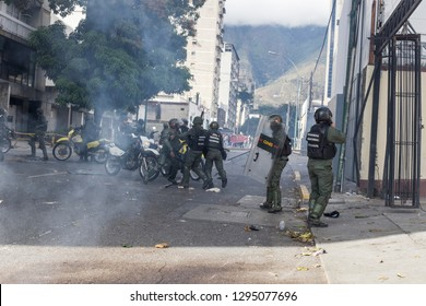 Caracas, Miranda/Venezuela - January 23rd 2019: Demonstrator fights to avoid detention after attending rally in support of Venezuela's National Assembly President Juan Guaido.