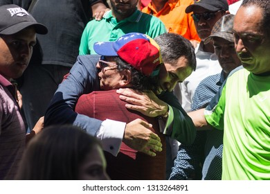 Caracas, VE (02/12/19) - Venezuelan president (I) Juan Guaido hugs a supporter after announcing humanitarian aid to be delivered on the next few days at several border crossings.