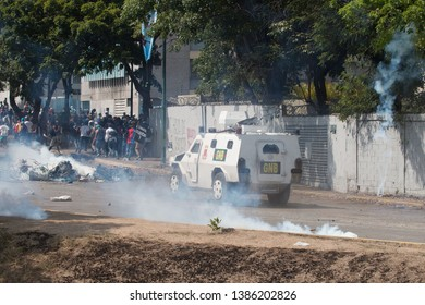 Caracas VE 5-1-19 Maduro's police and military forces equipped with shotguns tear gas and anty-riot vehicles  fought all day long against unarmed civilians who were protesting against the government