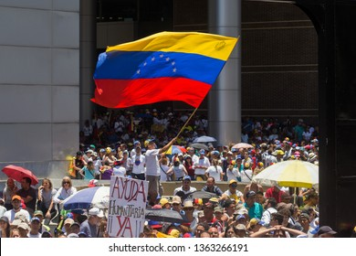 Caracas, VE (6/4/19) - Huge venezuelan flag is waved at venezuelan opposition protest against recent blackouts that have affected the entire country..