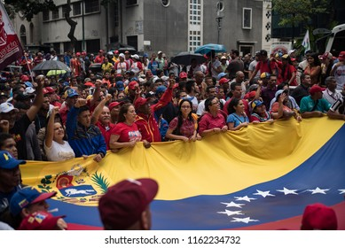 Caracas, Venezuela; 08/21/2018. People participate in a march in favor of the economic policies of President Nicolás Maduro.
