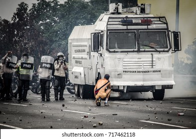 CARACAS, VENEZUELA - APRIL 20, 2017: Protest in Caracas, Venezuela against the government of Nicolas Maduro. A naked man confronts the national guard and asks to stop the repression against the people