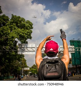 CARACAS, VENEZUELA - APRIL 26, 2017: Protest in Caracas, Venezuela against the government of Nicolas Maduro. Demonstrator shows the expired tear gas bombs that are firing at them.