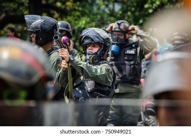 CARACAS, VENEZUELA - APRIL 26, 2017: Protest in Caracas, Venezuela against the government of Nicolas Maduro. The Bolivarian National Guard shoot tear gas bombs to the protesters.