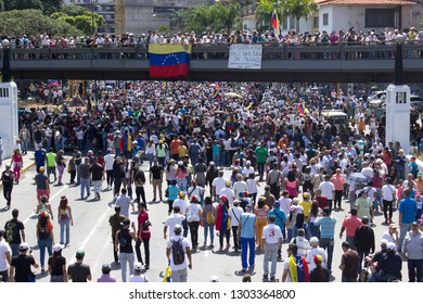 Caracas / Venezuela February 2, 2019: Huge crowds of opposition supporters take part in a rally against Venezuelan President Nicolas Maduro government and back Juan Guaido interim president