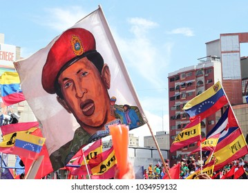CARACAS, VENEZUELA- FEBRUARY 27, 2018: Hugo Chavez image is seen on a flag that is waved during an event where Nicolas Maduro register as Candidate for April Presidential Election in Venezuela