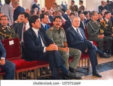 CARACAS, VENEZUELA - FEBRUARY 3, 1989: President of Peru Alan Garcia, left, with Nicaragua President Daniel Ortega (military uniform), attend inauguration of Venezuela President Carlos Andres Perez.