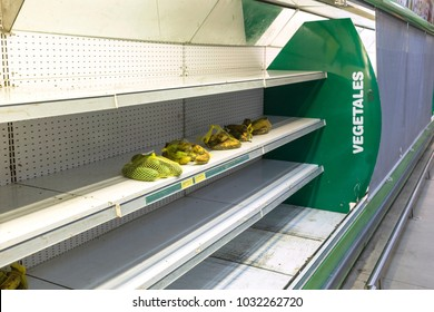 CARACAS, VENEZUELA - JANUARY 14, 2018: Empty supermarket shelves in Venezuela. Due to the economic crisis and hyperinflation in Venezuela there is a large shortage of food and medicine