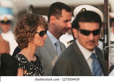 Caracas (Venezuela) June 25, 2010. Bashar al-Assad (C), president of Syria, and his wife Asma al-Assad (L), on arrival to Caracas, Venezuela, on official visit in June 25, 2010. Photo/Harold Escalona