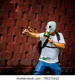 CARACAS, VENEZUELA - MAY 01, 2017: Protest in Caracas, Venezuela against the government of Nicolas Maduro. Demonstrator defends himself from the repression of the national guard by throwing stones.