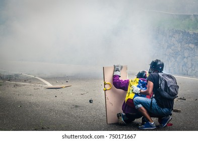 CARACAS, VENEZUELA - MAY 01, 2017: Protest in Caracas, Venezuela against the government of Nicolas Maduro. Demonstrators use shields to resist the repression of the national guard.