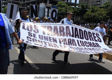 Caracas, Venezuela, May 1, 2019: Workers claims for higher salaries and the resignation of Nicolas Maduro on international workers day in Caracas, Venezuela.