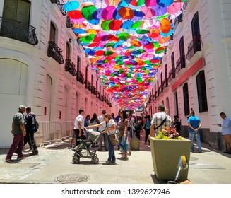 Caracas, Venezuela May 15, 2019: People walking along the busy Linares street in downtown Caracas historic centre covered with colorful umbrellas