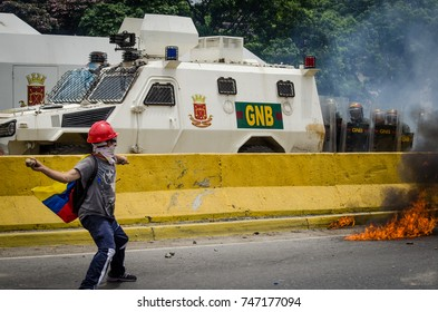 CARACAS, VENEZUELA - MAY 3, 2017: Protest in Caracas, Venezuela. tanqueta of the Bolivarian National Guard is attacked with Molotov cocktails launched by the Venezuelan resistance.