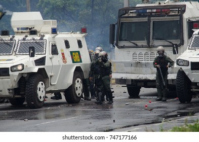 CARACAS, VENEZUELA - MAY 3, 2017: Protest in Caracas, Venezuela. Bolivarian national guard pointing with his shotgun against protesters and press.