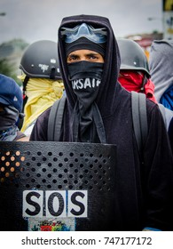 CARACAS, VENEZUELA - MAY 3, 2017: Protest in Caracas, Venezuela. Young member of the Venezuelan resistance holds a shield with which they defend themselves against the repression