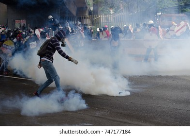 CARACAS, VENEZUELA - MAY 3, 2017: Protest in Caracas, Venezuela. Protesters are repressed with tear gas bombs and they use gloves to throw them back.