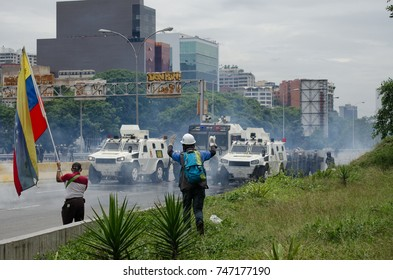 CARACAS, VENEZUELA - MAY 3, 2017: Protest in Caracas, Venezuela. a member of first aid with hands raised asks the national guard to be able to help the deputy of the third age.