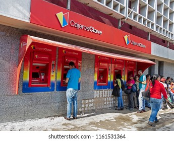CARACAS, VENEZUELA-AUGUST 21, 2018: Unidentified people queue at a Bank of Venezuela ATMs to withdraw money. New banknotes have been available to public starting from today.