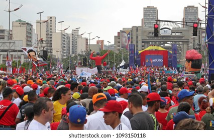 CARACAS, VENEZUELA-MAY 17, 2018: People crowd the Bolivar Avenue during an event for Nicolas Maduro Presidential Closing Campaign in Venezuela.