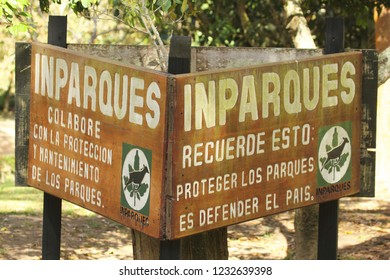 "Caracas/Venezuela- 27 October 2018: A park signal in El Avila National Park by INPARQUES stating ""Help us to protect the nature"" to conservate plants and wildlife at a vulnerable nature area"