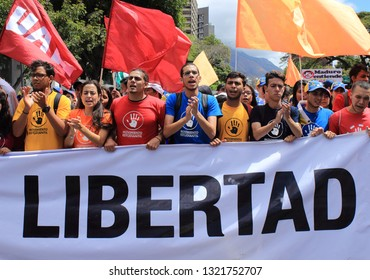 Caracas/Venezuela February 23, 2019: People gather at military barracks to ask soldiers for their help in the humanitarian aid effort waving the Venezuelan flag and freedom signs against Maduro regime