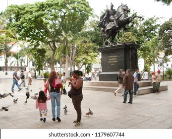 CARACAS/VENEZUELA - MAY 06, 2018  View of square bolivar in downtown Caracas historic centre with people walking and feeding the birds