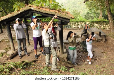 Caracas/Venezuela October 27, 2018: Naturalist in the outdoors learning how to identify bird species and birdwatching basis in the outdoors El Avila National Park