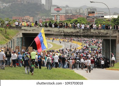 Caracas/Venezuela-04/26/2017: Protesters closed a highway in Caracas while participating in the event called The mother of all protests in Venezuela against Nicolas Maduro government