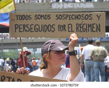 Caracas/Venezuela-04/26/2017: Protesters of the government of Nicolas Maduro and former president Hugo Chavez concentrated in the streets of Caracas with banners that reads we are all persecuted