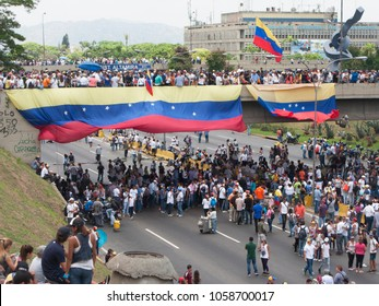Caracas/Venezuela-04/26/2017: Protesters participating in the event called The mother of all protests in Venezuela against Nicolas Maduro government
