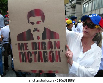 Caracas/Venezuela-April 20, 2017: A woman holds a cartoon of Nicolas Maduro during opposition rally against the dictator